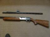 REMINGTON 1100 20 GA. LEFT HAND, CHOICE OF BARRELS, EXC. COND.