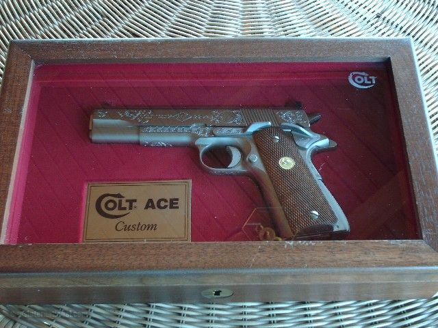 COLT ACE 22 CAL.ELECTROLESS NICKEL, FACTORY ENGRAVED, IN COLT FACTORY CASE WITH
