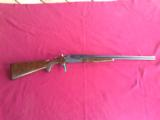 STEVENS SAVAGE M-24, 22 LR. OVER 410 GA. CASE COLOR LIKE NEW, TENITE STOCK, MFG.1940 TO 1949