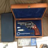 "SMITH & WESSON MODEL 57 NO DASH, 4"" BLUE, APPEARS UNFIRED, COMES IN PRESENTATION WOOD BOX WITH CLEANING TOOLS, OWNERS MANUAL, ETC.,"