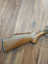 SAVAGE M-24 DELUXE, 22 LR. OVER 410 GA. WHITE OUTLINED CHECKERED WALNUT WOOD, GOLD TRIGGER, SATIN SILVER ENGRAVED RECEIVER - 6 of 6