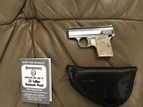 "BROWNING BELGIUM ""BABY"" 25 AUTO, NICKEL WITH GOLD TRIGGER, COMES WITH OWNERS MANUAL, ZIPPER POUCH, EXCELLENT COND."