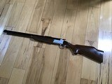 SAVAGE 24 DELUXE, 22 LR. OVER 410 GA., SATIN SILVER ENGRAVED RECEIVER WITH RED FOX ON ONE SIDE AND GROUSE IN FLIGHT ON OTHER SIDE, EXC. COND.