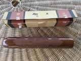 REMINGTON 1100, 12 GA. FOREARM, NEW NEVER BEEN ON A GUN, 100% COND. IN REMINGTON DUPONT BOX