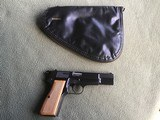 BROWNING HI POWER 9MM, MFG. 1966, RING HAMMER, APPEARS UNFIRED, 100% COND. COMES WITH ORIGINAL BROWNING ZIPPER CASE