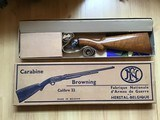 BROWNING BELGIUM TROMBONE 22 LR. PUMP, NEW UNFIRED IN THE BOX, WITH OWNER MANUAL,100% COND. AND THE BOX IS LIKE NEW