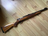 REMINGTON 600, 350 MAGNUM, LAMINATED WOOD STOCK, VENT RIB BARREL, AS NEW COND.