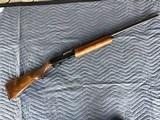 "remington 1100, 16 ga., 28"" mod., vent rib, very fancy wood with lots of figure, 99% cond. no box"