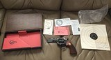 "COLT PYTHON 357 MAGNUM, 4"" BLUE, MFG. 1969, AS NEW COND.,COMES WITH TEST TARGET, OWNERS MANUAL, HANG TAG, ETC. IN THE BOX - 1 of 8"