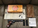 """RUGER MARK I, TARGET, 22 LR. 6 7/8"""" BARREL, 99+% COND. COMES WITH 2 SETS OF GRIPS, APPEARS UNFIRED, IN THE BOX"""