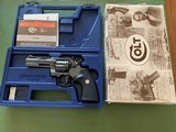"""COLT PYTHON 357 MAGNUM, 4"""" ROYAL BLUE, LIGHT TURN ON THE CYLINDER, COMES WITH OWNERS MANUAL IN THE PICTURE BOX"""