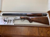 "RUGER RED LABEL 28 GA., 28"" BARRELS, 5 CHOKE TUBES & WRENCH, OUTSTANDING WOOD, AS NEW IN THE BOX WITH OWNERS MANUAL - 1 of 6"