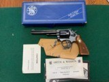 "SMITH & WESSON 48-3, 22 MAGNUM, 6 "" BLUE, LKE NEW IN THE BOX WITH OWNERS MANUAL, ETC."