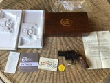 """COLT PYTHON 357 MAGNUM, 2 1/2"""" BLUE, MFG. 1979, APPEARS TO HAVE ONLY BEEN FACTORY FIRED, AS NEW IN THE BOX."""