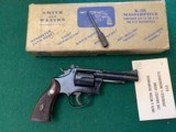 "smith & wesson k-38, 4"" blue, in the box with cleaning tool"