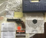 """COLT PYTHON 357 MAGNUM, """"ELITE"""" 6"""" """"ROYAL BLUE"""" UNTURNED AFTER LEAVING THE FACTORY, NO TURN LINE, 100% COND. FACTORY TEST TARGET, IN THE BOX."""