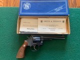 """SMITH & WESSON 48-4, 22 MAGNUM, 6"""" BLUE, APPEARS UNFIRED AFTER LEAVIG THE FACTORY, COMES IN THE BOX WITH OWNERS MANUAL, OIL PAPER, ETC."""