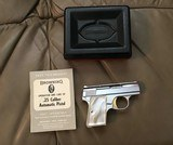 BROWNING BELGIUM BABY 25 AUTO RARE BRIGHT NICKEL, GOLD TRIGGER, PEARLITE GRIPS, NEW UNFIRED IN THE BOX WITH OWNERS MANUAL