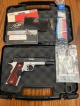 KIMBER 1911, 45 ACP., CUSTOM CRIMSON CARRY II WITH. RED LAZER, NEW UNFIRED IN THE BOX