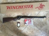 """WINCHESTER 9422 22 LR. HIGH GRADE, LEGACY, WITH GOLD HORSE RIDER ON THE RECEIVER, FANCY WALNUT, 22"""" BARREL, NEW UNFIRED IN THE BOX WITH OWNERS MANUAL"""