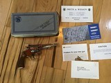 """SMITH & WESSON 34-1, 22/32 KIT GUN, 22 LR. 4"""" NICKEL NEW UNFIRED IN THE BOX WITH OWNERS MANUAL"""