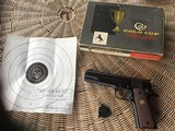 COLT GOLD CUP PRE SERIES 70, 45 AUTO CAL. MFG. 1958, NEW UNFIRED UNHANDLED IN FACTORY GREASE & PLASTIC WRAP, IN GOLD CUP BOX WITH TEST TARGET & TOOL - 1 of 5