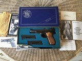 SMITH & WESSON 52-2, 38 CAL. NEW, 100% COND. IN THE BOX 2 MAG'S, CLEANING TOOLS, OWNERS MANUAL, ETC.