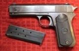 Colt 1903 Pocket Hammer .38 Special Rimless Caliber Pistol.