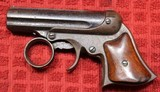 E. Remington & Sons, Elliot's patent Ring Trigger 5 Shot Derringer in 22 caliber rimfire.