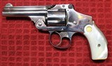 "Nickel Plated .38 S&W Safety Hammerless Fourth Model 3 1/4"" 5 shot Revolver with Pearl S&W logo grips"