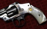 """Nickel Plated .38 S&W Safety Hammerless Fourth Model 3 1/4"""" 5 shot Revolver with Pearl S&W logo grips - 4 of 25"""