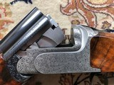 "Perazzi MX12 SC3 #100 Scroll Engr, 32"" blls with Carrier Barrells & 20,28,410 Briley Ultra Lite Tubes."