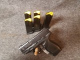 Used Taurus PT 24/7 in 9MM with 6mags.
