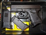 GLOCK 27 (CAN BE SOLD IN MASS.) - 1 of 4