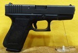 GLOCK 23 (CAN BE SOLD IN MASS.) - 1 of 2