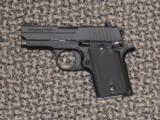 SIG SAUER P-938 ALL BLACK/AMBI 9 MM - 1 of 3