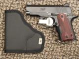 KIMBER MICRO CARRY .380 ACP WITH ROSEWOOD CRIMSON TRACE LASER - 1 of 4