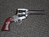 RUGER STAINLESS 4-3/4-INCH FLAT-TOP CONVERTIBLE REVOLVER IN 9 MM & .357 MAGNUM!!