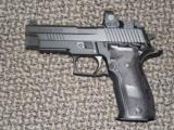 SIG SAUER MODEL P-226 RX 9 MM SAO PISTOL WITH FACTORY-INSTALLED RMR SIGHT