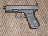 GLOCK MODEL 19 CUSTOM WITH THREADED BARREL AND SNAKE EYES NIGHT SIGHTS