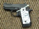 SIG SAUER MODEL P-238 POCKET PISTOL WITH CUSTOM GRIPS AND TWO MAGAZINES