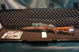 Remington Custom Shop 547 D Grade 17HMR factory engraved new in the factory deluxe case.