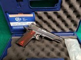 "COLT - MODEL 1911. GOVERNMENT MODEL. ""XSE"". 5 INCH BARREL. BLUED IN ORIGINAL CASE. W-2 MAGAZINES. NEAR NEW! - .45 ACP"