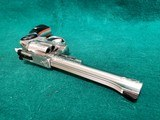 RUGER - SECURITY SIX. STAINLESS. DOUBLE ACTION. 6 INCH BARREL. ENGRAVED BY CLINT FINLEY.GORGEOUS! MFG. IN 1977 - .357 MAGNUM - 19 of 21