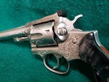 RUGER - SECURITY SIX. STAINLESS. DOUBLE ACTION. 6 INCH BARREL. ENGRAVED BY CLINT FINLEY.GORGEOUS! MFG. IN 1977 - .357 MAGNUM - 15 of 21