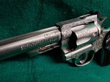 RUGER - SECURITY SIX. STAINLESS. DOUBLE ACTION. 6 INCH BARREL. ENGRAVED BY CLINT FINLEY.GORGEOUS! MFG. IN 1977 - .357 MAGNUM - 16 of 21