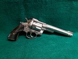 RUGER - SECURITY SIX. STAINLESS. DOUBLE ACTION. 6 INCH BARREL. ENGRAVED BY CLINT FINLEY.GORGEOUS! MFG. IN 1977 - .357 MAGNUM - 1 of 21