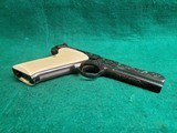 """Colt - WOODSMAN. MATCH TARGET. 3RD MODEL. 4.5"""" BARREL. IVORY GRIPS. EXQUISITELY ENGRAVED BY MASTER ENGRAVER CLINT FINLEY. MFG IN 1972 - .22 LR - 25 of 26"""