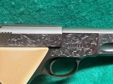 """Colt - WOODSMAN. MATCH TARGET. 3RD MODEL. 4.5"""" BARREL. IVORY GRIPS. EXQUISITELY ENGRAVED BY MASTER ENGRAVER CLINT FINLEY. MFG IN 1972 - .22 LR - 17 of 26"""