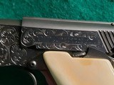 """Colt - WOODSMAN. MATCH TARGET. 3RD MODEL. 4.5"""" BARREL. IVORY GRIPS. EXQUISITELY ENGRAVED BY MASTER ENGRAVER CLINT FINLEY. MFG IN 1972 - .22 LR - 24 of 26"""